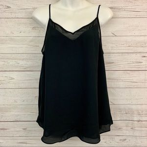 1. State mesh inset solid black swing cami tank